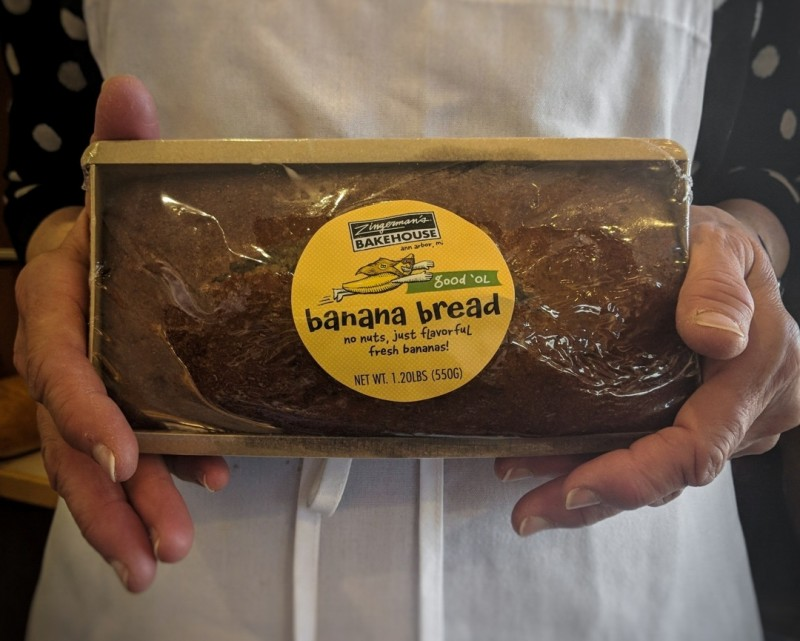 Cathy holding a loaf of banana bread