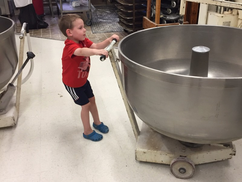 Randy's child pulling a big bowl of dough