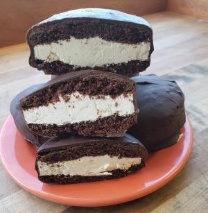 Swiss Buttercream filled chocolate cake sandwiches covered in chocolate