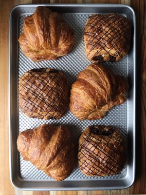 Classic and chocolate french desserts pastry croissant class on a baking sheet