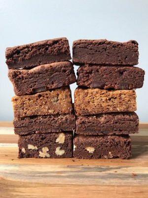 Two stack of brownies, pecan blondies, and Buenos Aires brownies