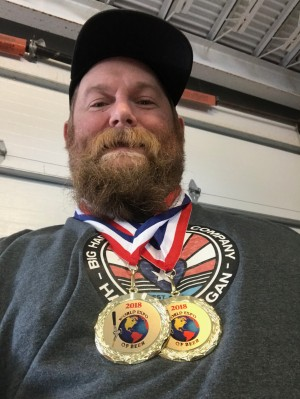 Teo Watson-Ahlbrandt with beer medals